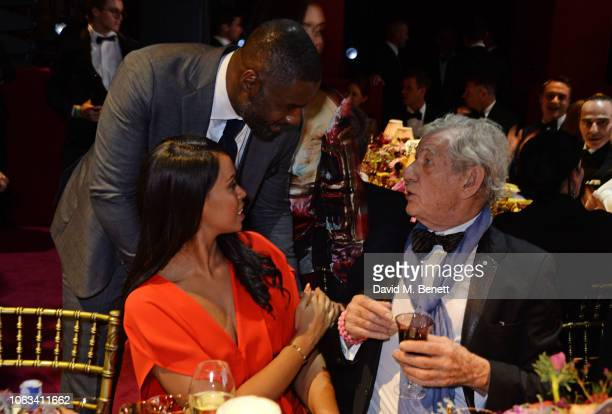Sabrina Dhowre Idris Elba and Sir Ian McKellen attend The 64th Evening Standard Theatre Awards at the Theatre Royal Drury Lane on November 18 2018 in...