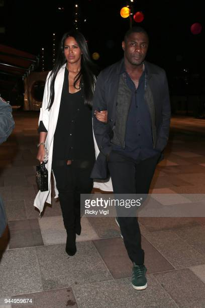 Sabrina Dowhre and Idris Elba seen attending Soho House White City launch party on April 11 2018 in London England