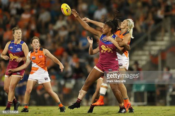 Sabrina FrederickTraub of the Lions and Renee Tomkins of the Giants compete for the ball during the round seven AFLW match between the Greater...