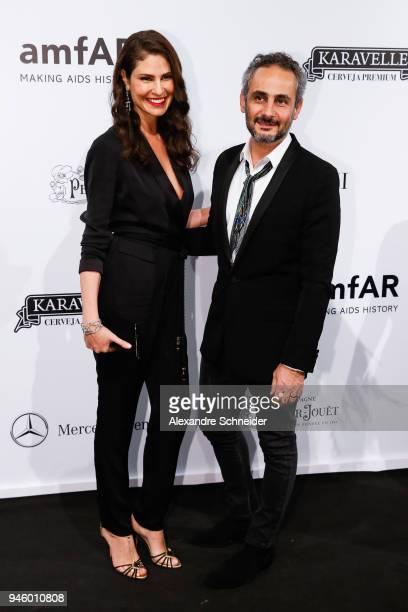 Sabrina Gasperin and Ara Vartanian attend the 2018 amfAR Gala Sao Paulo at the home of Dinho Diniz on April 13 2018 in Sao Paulo Brazil