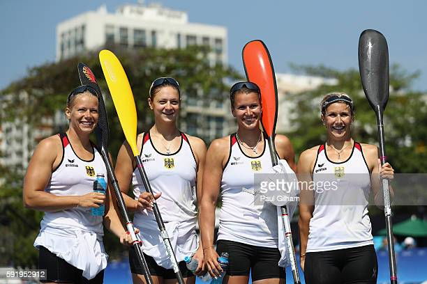 Sabrina Hering Franziska Weber Steffi Kriegerstein and Tina Dietze of Germany pose for a photo following the Women's Kayak Four 500m on Day 14 of the...