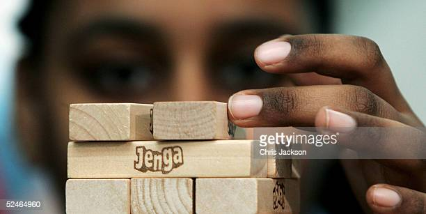 Sabrina Ibrahim works with her team in an attempt to break their teams previous Jenga record of 30 levels in 11 minutes and 55 seconds at The...