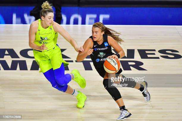 Sabrina Ionescu of the New York Liberty gets around Katie Lou Samuelson of the Dallas Wings during the second half of a game at Feld Entertainment...