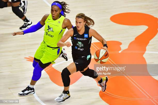 Sabrina Ionescu of the New York Liberty gets pressure from Kayla Thornton of the Dallas Wings during the second half of a game at Feld Entertainment...