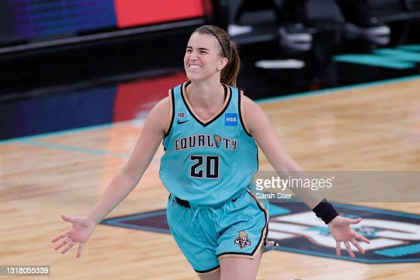 Sabrina Ionescu of the New York Liberty reacts after making a three-point basket in the final seconds of the second half against the Indiana Fever at...