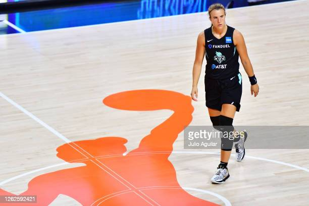 Sabrina Ionescu of the New York Liberty walks across the court during the second half of a game against the Dallas Wings at Feld Entertainment Center...