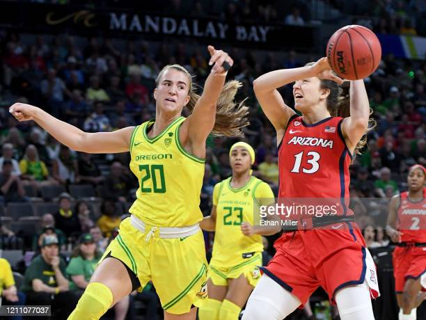Sabrina Ionescu of the Oregon Ducks knocks the ball away from Helena Pueyo of the Arizona Wildcats on a fast break during the Pac-12 Conference...