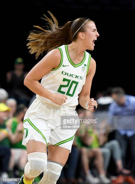 Sabrina Ionescu of the Oregon Ducks reacts after a teammate hit a 3-pointer against the Utah Utes during the Pac-12 Conference women's basketball...