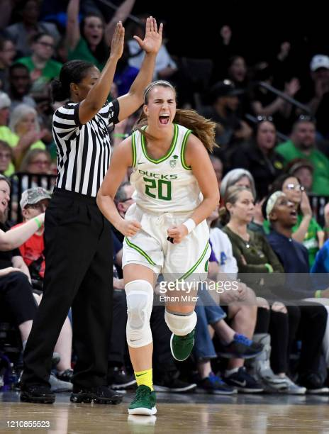 Sabrina Ionescu of the Oregon Ducks reacts after hitting a 3-pointer against the Utah Utes during the Pac-12 Conference women's basketball tournament...