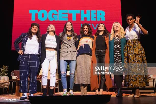 Sabrina Jalees Milck Sue Bird Jennifer Rudolph Walsh Sophia Bush Cheryl Strayed and Liliane Kamikazi stand together on stage during 'Together Live'...