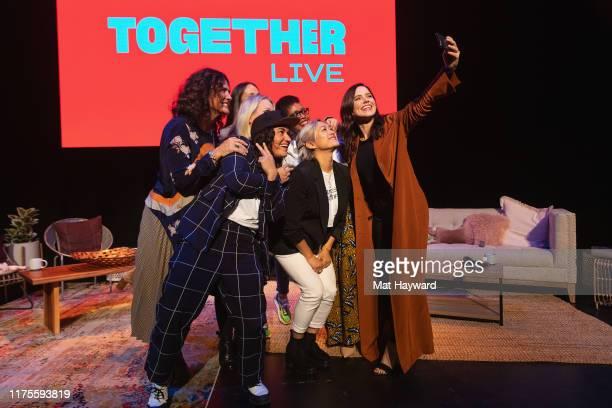 Sabrina Jalees Milck Sue Bird Jennifer Rudolph Walsh Sophia Bush Cheryl Strayed and Liliane Kamikazi pose for a selfie on stage during 'Together...