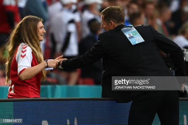 Sabrina Kvist Jensen , partner of Denmark's midfielder Christian Eriksen, reacts after Eriksen collapsed during the UEFA EURO 2020 Group B football...