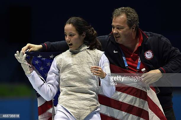 Sabrina Massialas of the United States celebrates her victory over Karin Miyawaki of Japan in the Women's Foil Individual final match on day one of...