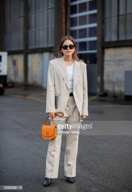 Sabrina Meijer wearing suit outside Rodebjer during Copenhagen Fashion Week Autumn/Winter 2020 Day 3 on January 30, 2020 in Copenhagen, Denmark.