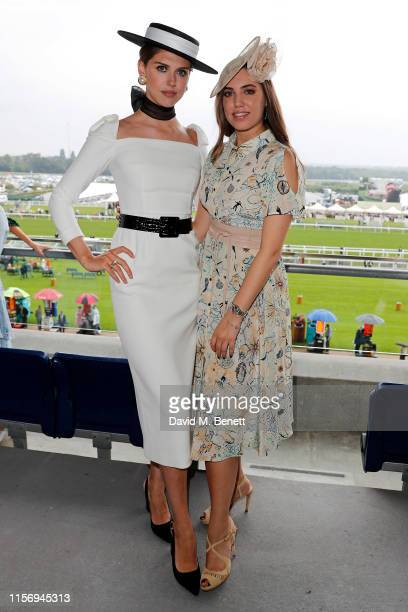 Sabrina Percy, wearing hat by Suzannah and Emily London and Amber Le Bon, wearing hat by Jane Taylor on day 2 of Royal Ascot at Ascot Racecourse on...