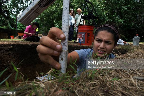 Sabrina Shirazi gathers data during an archaeological dig in Easton MD on July 24 2013 The dig is in a historic African American neighborhood which...