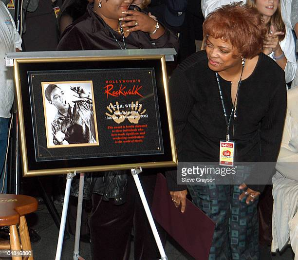 Sabrina Wilson daughter of the late singer Jackie Wilson admires a plaque honoring her father's induction into the RockWalk of Fame