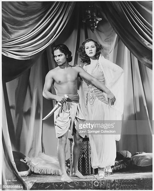 Sabu as Ali Ben Ali and Maria Montez as Sherazade in the 1942 film Arabian Nights