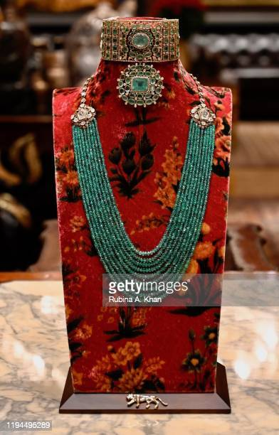 Sabyasachi necklaces in emeralds and diamonds on a floral velvet bust at Sabyasachi Jewelry Indian couturier and jewelry designer Sabyasachi's first...