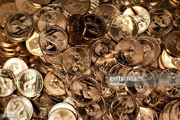 Sacagawea dollar coins sit in a bin after being struck at the United States Mint in Philadelphia Pennsylvania US on Thursday Feb 25 2010 The US...