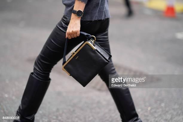 Sacai black bag is seen during London Fashion Week September 2017 on September 16 2017 in London England