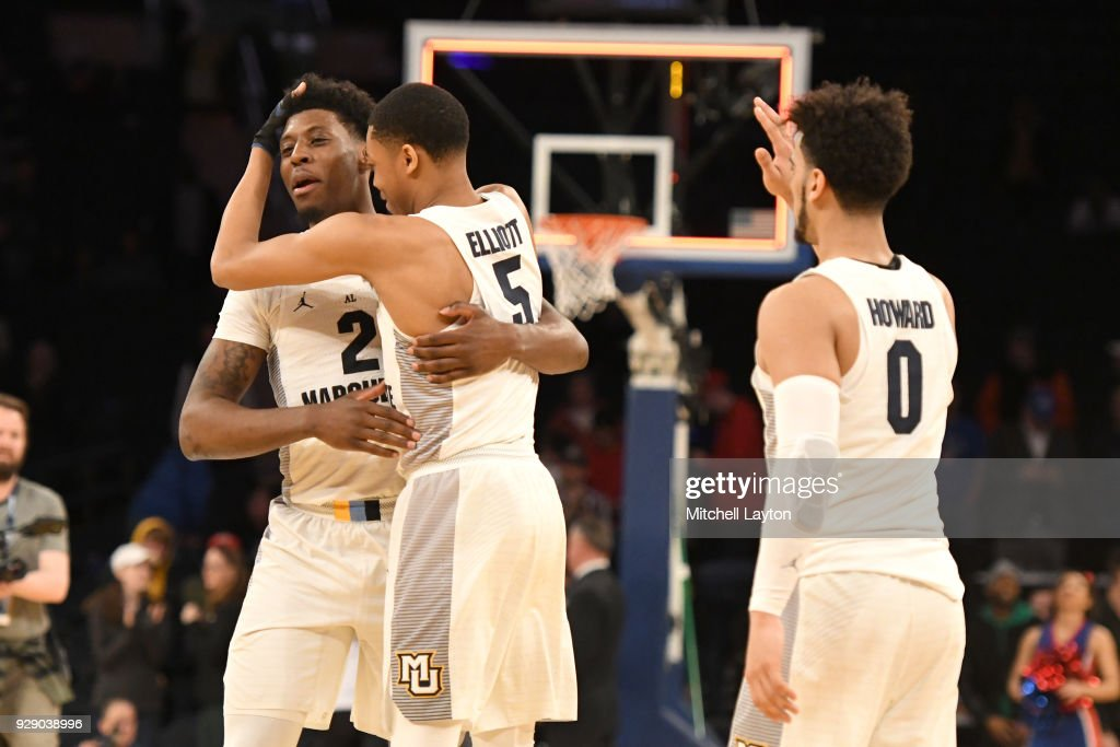Sacar Anim #2, Greg Elliott #5 and Markus Howard #0 of the Marquette Golden Eagles celebrate a win after the first round of the Big East Men's Basketball Tournament against the DePaul Blue Demons at Madison Square Garden on March 7, 2018 in New York City. Photo by Mitchell Layton/Getty Images)