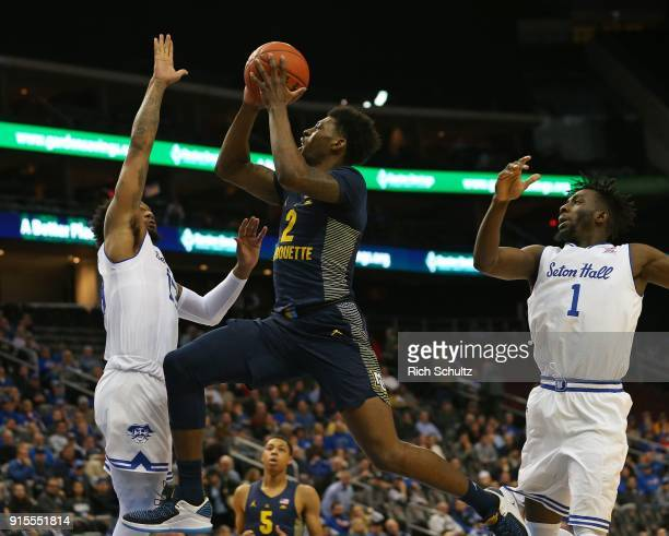 Sacar Anim of the Marquette Golden Eagles attempts a shot and is fouled by Myles Powell of the Seton Hall Pirates during the first half of a game at...