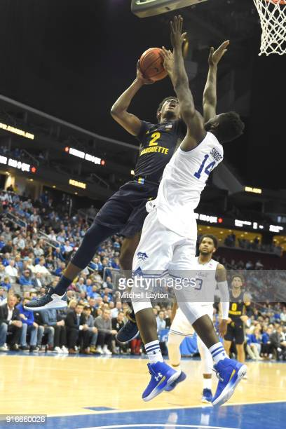 Sacar Anim of the Marquette Golden Eagles takes a jump shot over Ismael Sanogo of the Seton Hall Piratesl during a college basketball game at the...