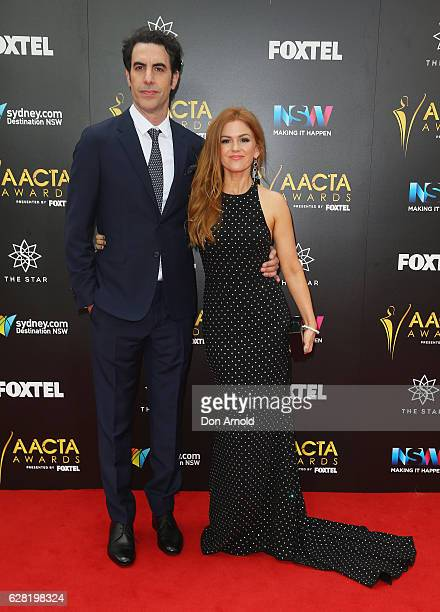 Sacha Baron Cohen and Isla Fisher arrive ahead of the 6th AACTA Awards at The Star on December 7 2016 in Sydney Australia