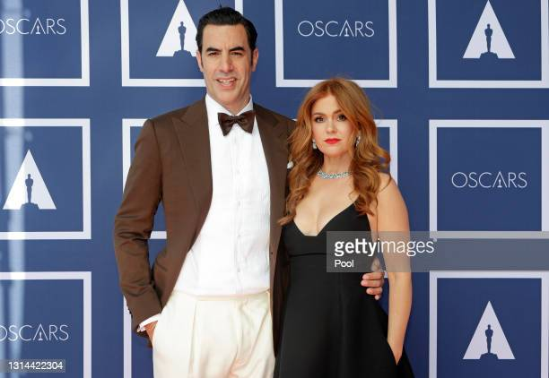 Sacha Baron Cohen and Isla Fisher attend a screening of the Oscars on Monday April 26, 2021 in Sydney, Australia.
