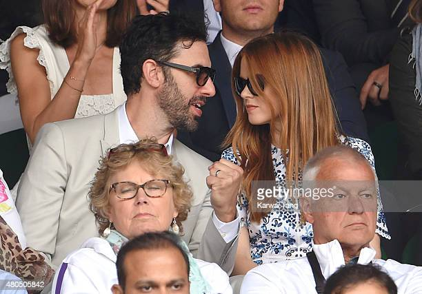 Sacha Baron Cohen and Isla Fisher attend day 13 of the Wimbledon Tennis Championships at Wimbledon on July 12, 2015 in London, England.