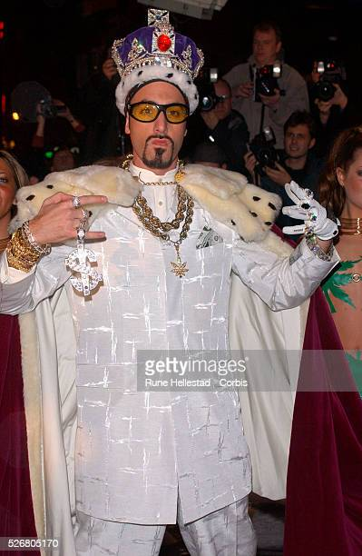 Sacha Baron Cohen known as Ali G arrives dressed as a king at the premiere of his film 'Ali G Indahouse' in London