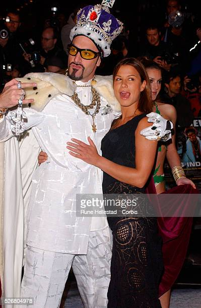 Sacha Baron Cohen known as Ali G dressed as a king and actress Rhona Mitra attend the premiere of their film 'Ali G Indahouse' in London