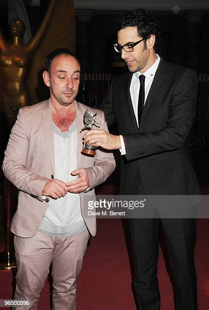 Sacha Baron Cohen with The Peter Sellers Award For Comedy with Dan Mazer attend the London Evening Standard British Film Awards 2010 at The London...