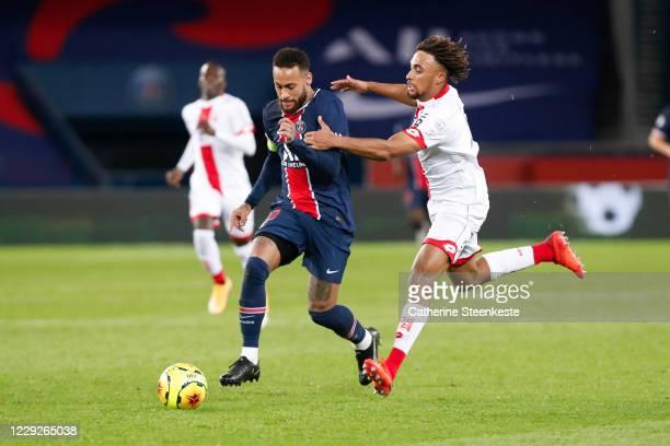 Sacha Boey of Dijon FCO challenges Neymar Jr of Paris SaintGermain during the Ligue 1 match between Paris SaintGermain and Dijon FCO at Parc des...