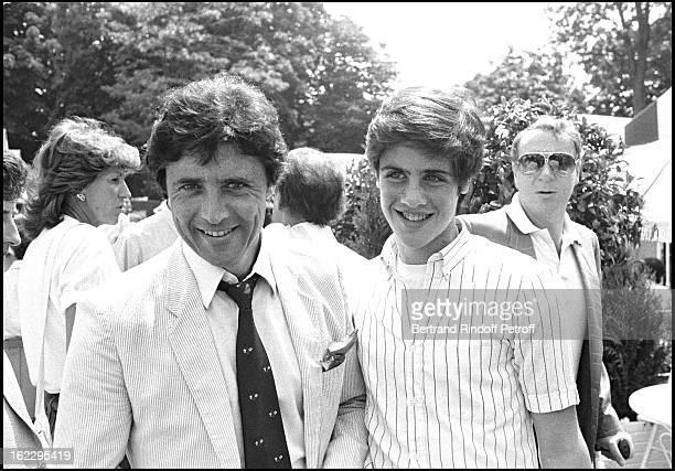 Sacha Distel and his son Julien at 1983 Roland Garros tennis tournament