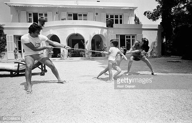 Sacha Distel and his wife Francine play with their sons Julien and Laurent | Location Le Rayol Alpes Maritimes France