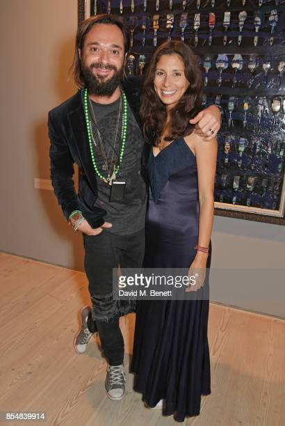 Sacha Jafri and Jasmine Hemsley attend the private view and launch of Sacha Jafri's 18 year retrospective global tour 'Universal Consciousnes' at The...