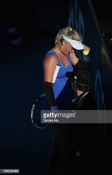 Sacha Jones of New Zealand is in pain with an injury during her match against Elena Baltacha of Great Britain during day one of the 2012 ASB Classic...