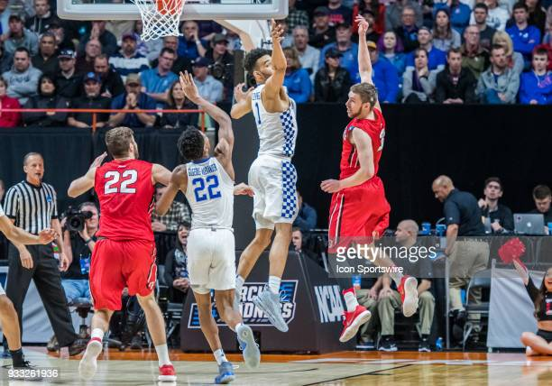 Sacha KilleyaJones of the Kentucky Wildcats and G Jordan Watkins of the Davidson Wildcats miss a rebound during the NCAA Division I Men's...