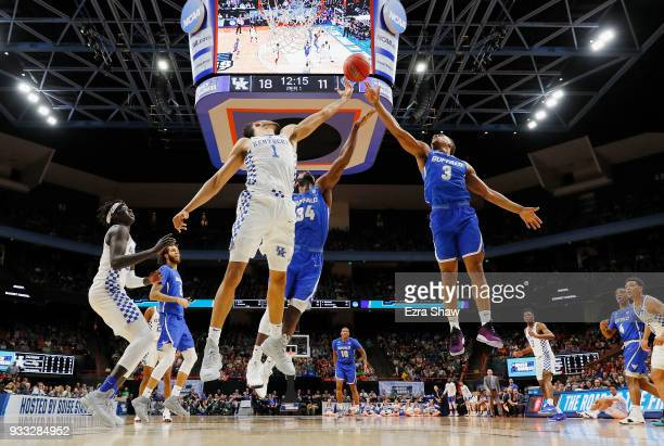 Sacha KilleyaJones of the Kentucky Wildcats battles for a rebound with Ikenna Smart and Jayvon Graves of the Buffalo Bulls in the second round of the...