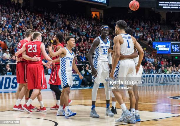 Sacha KilleyaJones of the Kentucky Wildcats gets congratulations for a three point basket and a foul opportunity during the NCAA Division I Men's...