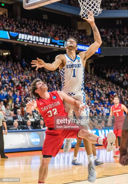 Sacha KilleyaJones of the Kentucky Wildcats goes up for a rebound over G Rusty Reigel of the Davidson Wildcats during the NCAA Division I Men's...