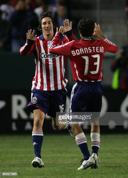 Sacha Kljestan and Jonathan Bornstein of CD Chivas USA celebrate Kljestan's first half goal against Real Salt Lake during their MLS game at the Home...