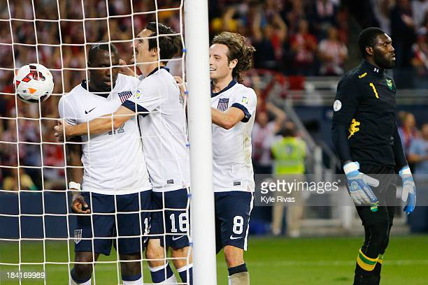 Sacha Kljestan and Mix Diskerud of the US Men's National Soccer Team celebrate the second goal of the game scored by Jozy Altidore against Jamaica at...