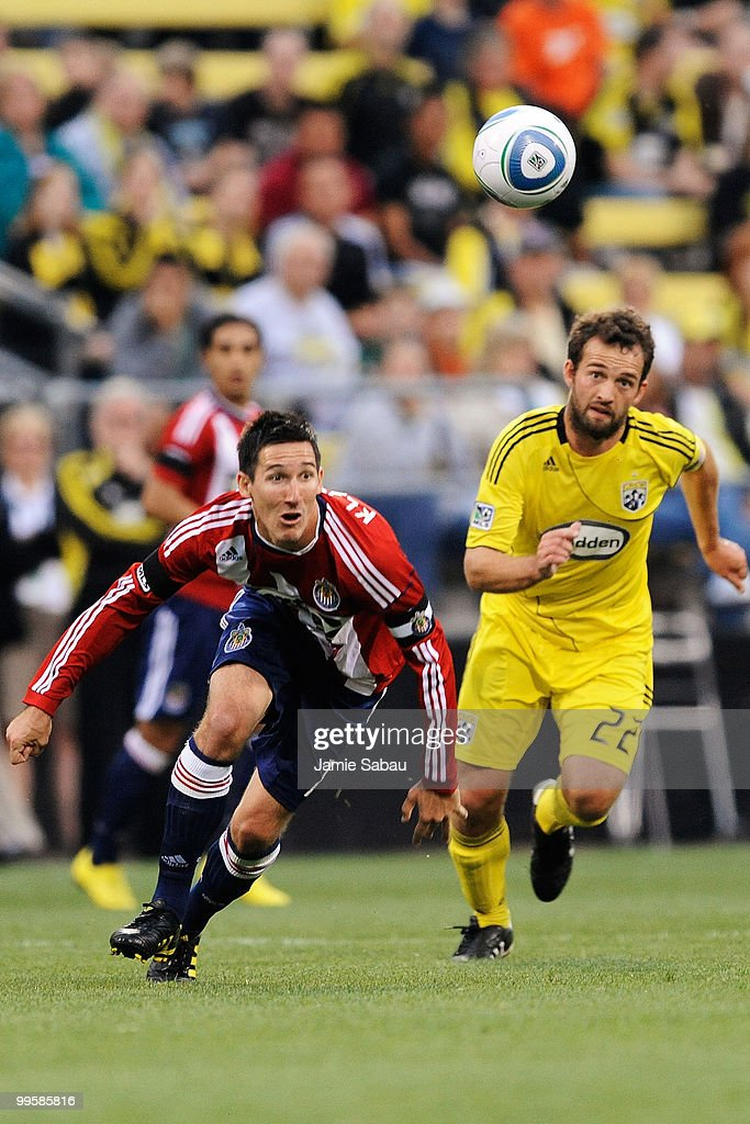 Sacha Kljestan #16 of Chivas USA and Adam Moffat #22 of the Columbus Crew chase down a loose ball on May 15, 2010 at Crew Stadium in Columbus, Ohio.