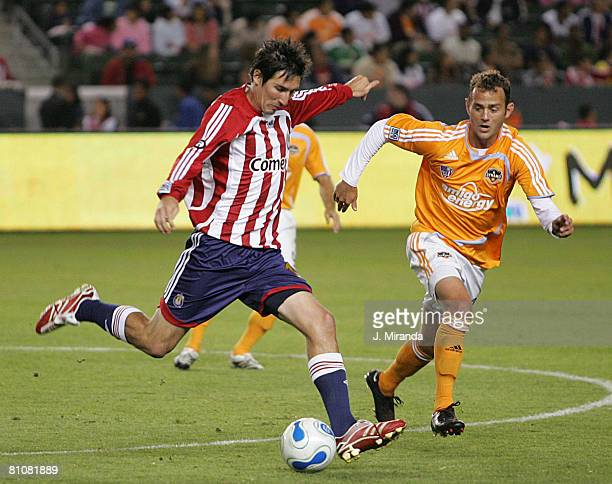 Sacha Kljestan of Chivas USA in action against Brad Davis of Houston Dynamo at The Home Depot Center October 20 2007 in Carson California Chivas...
