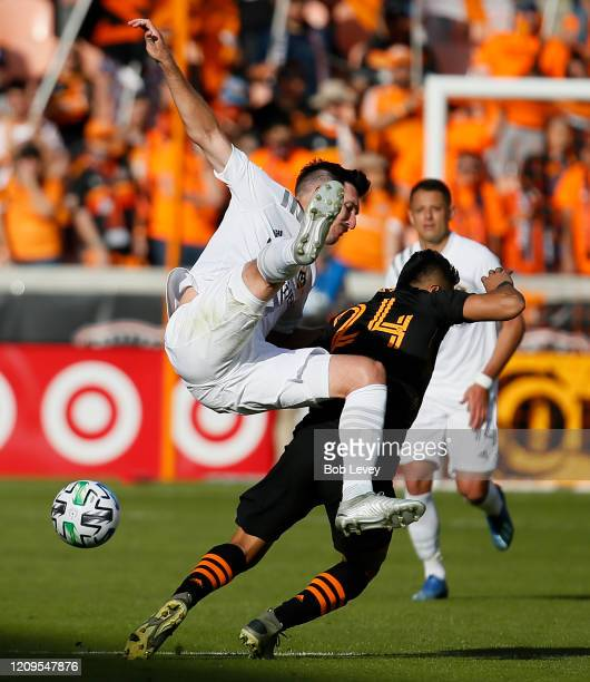Sacha Kljestan of Los Angeles Galaxy flips over the back of Darwin Ceren of Houston Dynamo during the second half at BBVA Stadium on February 29 2020...