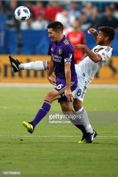 Sacha Kljestan of Orlando City SC and Jonathan dos Santos of the Los Angeles Galaxy fight for control of the ball at StubHub Center on July 29 2018...