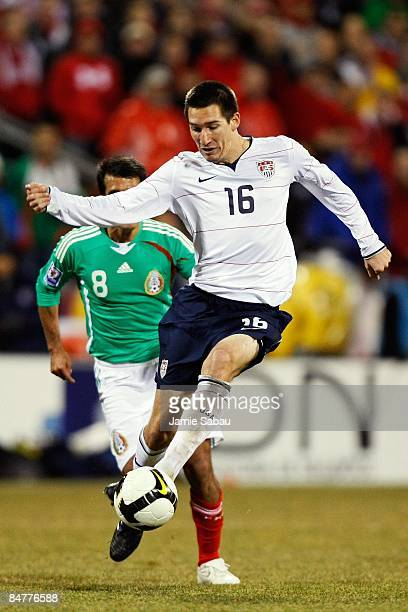 Sacha Kljestan of USA dribbles the ball against Mexico during a FIFA 2010 World Cup qualifying match in the CONCACAF region on February 11 2009 at...